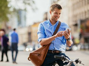 photo-of-a-handsome-man-with-bike-using-smartphone-000064632093_large-cropped
